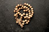 image of prayer beads  - rosary beads on old black background - JPG