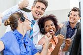 picture of telemarketing  - Cheerful customer service representatives and manager celebrating success in call center - JPG