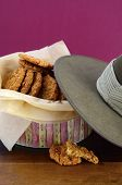 picture of biscuits  - Australian Anzac biscuits in vintage biscuit tin with army soldier slouch hat - JPG