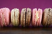 picture of marsala  - Delicious strawberry and chocolate macaroons on wood and marsala color background - JPG