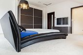 foto of enormous  - Enormous leather bed in big luxury room - JPG