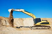 picture of excavator  - excavator machine doing excavation earthmoving work in sand quarry - JPG