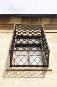 foto of wrought iron  - Old wooden window with wrought Iron grill - JPG