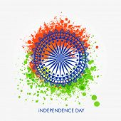 stock photo of indian independence day  - Beautiful floral design decorated Ashoka Wheel on saffron and green color splash background for Indian Independence Day celebration - JPG