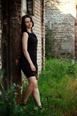 Girl Standing Amongst Ruins