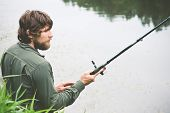picture of survival  - Young Man Fisherman bearded fishing with rod Lifestyle Travel survival concept river on background - JPG