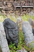 foto of stone sculpture  - Lava stone sculpture of a stylised man poured with water to make its design stand out - JPG