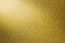 stock photo of nylons  - gold fabric nylon background texture with light from corner - JPG