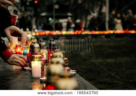 Crowd Of People Lighting Candles