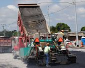 image of road construction  - Road construction crew paves a new lane on the highway - JPG