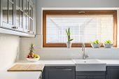 Light Kitchen With White Countertop poster