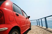 red car beside sea