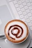 cappucino with email symbol on keyboard