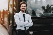 Young Smiling Businessman Standing In Front Of Bus. Confident Attractive Man Wearing White Shirt And poster