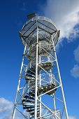 Spiral Staircase Of Lookout Tower, Construction With Metal Steps. Observation Tower, Post Or Point, poster