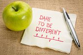 Dare to be different - sketching and handwriting on a napking with a green apple poster