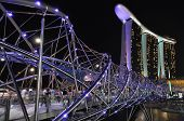 SINGAPORE - FEBRUARY 4: The new Marina Bay Sands resort and Helix Bridge on February 4, 2011 in Sing