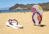 Flip-flops in the sand of Teresitas beach. Tenerife island, Canaries
