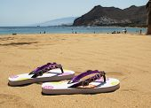 Flip-flops on the sand of Teresitas beach. Tenerife island, Canaries