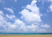 Summer seascape under blue sky with clouds