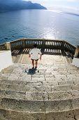 stock photo of salvatore  - Atrani on the coast of Amalfi man going downstairs of church of Salvatore Bireto - JPG