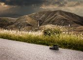 Landscape stormy one shoe worn on road