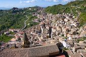 aerial view of dwelling and roofs of sicilian village and the countryside
