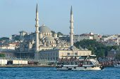 Yeni mosque and ferryboat in Bosphorus strait from Galata Bridge