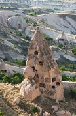 several 'pigeon house' carved in typical rock formation in Cappadocia, Turkey; the local farmers have used the pigeon droppings as fertiliser