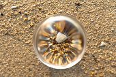 Crystal Glass Ball Sphere Reveals Sunrise Seascape With Spherical Perspective On The Beach In Phuket poster