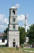 belltower of orthodox church and minaret of musulman mosque in republic of Macedonia