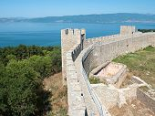 walls and towers embattled of castle Samuil, on background the blu waters of Ohrid lake, Republic Of