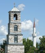 belltower of orthodox church and minaret of musulman mosque in republic of Macedonia (religious coexistence)