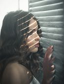 Sensual Woman With Makeup At Window. Fashion Woman With Makeup And Curly Hair. Fashion And Beauty. B poster