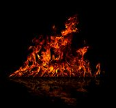 Fire reflected on floor, isolated on black background