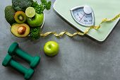 Diet And Healthy Life Concept. Green Apple And Weight Scale Measure Tap With Fresh Vegetable And Spo poster
