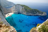 Top view of Navagio beach in Greece with cruisers anchoring next to beach