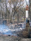 House burned to the ground, with smoldering ashes