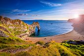 Sunlight Illuminates The Rocks Of Durdle Door On The South Dorset Jurassic Coast poster