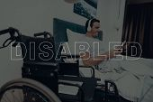 Disabled Man. Man Is Lying In Bed. Man Watching Video On Tablet Pc. Man Wearing Headphones. Man Is S poster