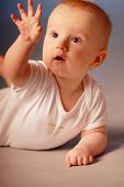 Little Boy Examining His Hand