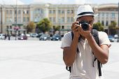 African-american Man Exploring And Photographing Landmarks In City, Copy Space poster