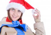 Woman holding two gifts winking and smiling isolated on white background