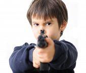 boy pointing gun at camera