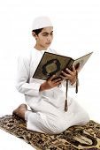 Little muslim boy with koran