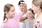 stock photo of measuring height  - Girls measuring height - JPG