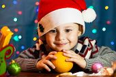 Little Cute Boy With Santa Hat. In The Background Bright Festive Lights poster
