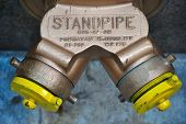 picture of hookup  - standpipe with siamese connection device for fire hoses - JPG
