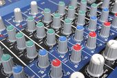 A mixing board on a preamp for amplifying audio signal.