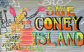 BROOKLYN - OCTOBER 25: Graffiti referring to Coney Island's historic amusement parks threatened by u
